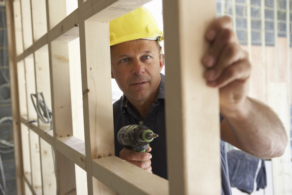 Construction Worker Building Timber Frame